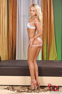 Long Legged Blond Beauty Strips Nude
