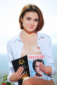 Alice Shea is reading a magazine