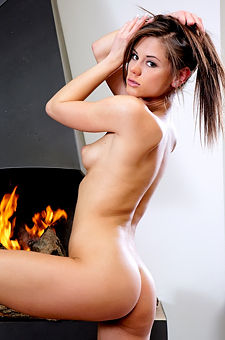 Little Caprice Is Nude By The Fireplace