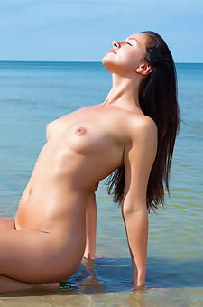 Naked Natural Teen Posing At The Beach