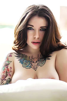 Busty Tattooed Babe Voly